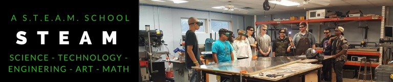 picture of robotics team learning to use the blowtorch